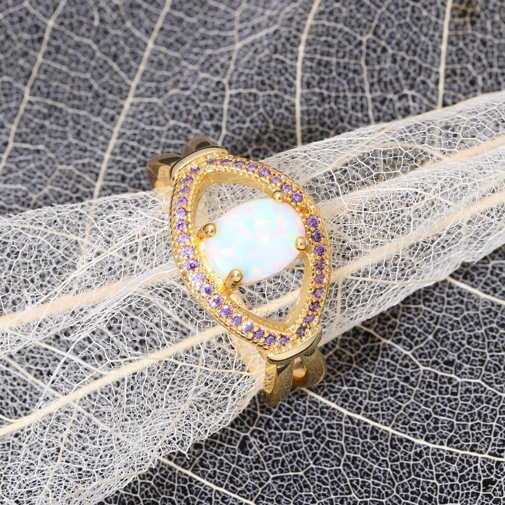 Красивое кольцо с огненным опалом в позолоте.20 размер.Кольцо - радужный опал!