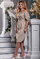 Очень красивое платье с вышивкой на рукавах.