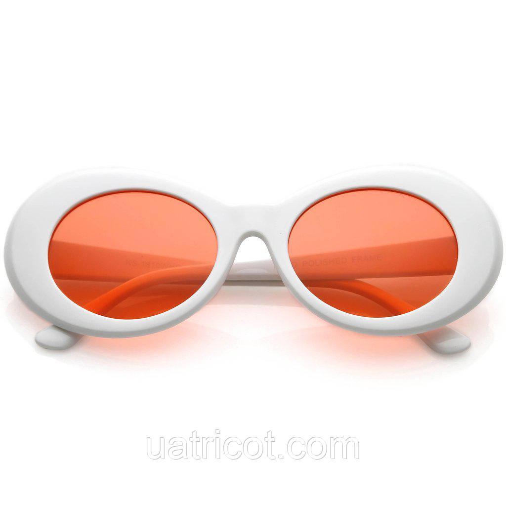 Овальные солнцезащитные очки с красной линзой