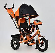 Велосипед 3х колесный Best Trike 7700. Поворотное сиденье, Игровая панель. Оранжевый