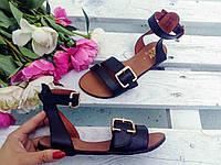 Женские сандалии/босоножки из натуральной кожи на низком ходу с ремешком вокруг щиколотки черного цвета