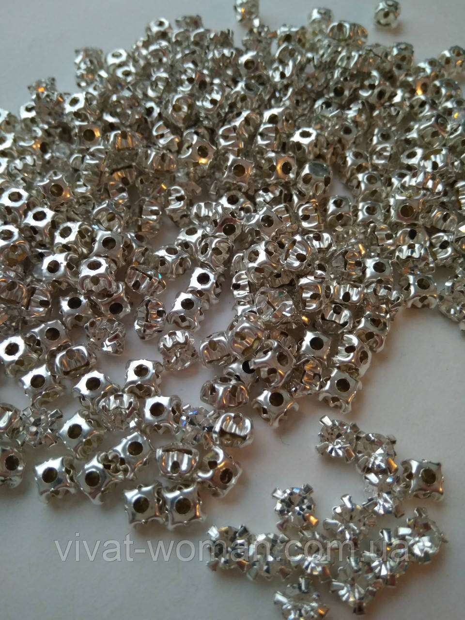 Стрази в цапах, Ріволі SS30 (5.5 mm), Crystal, срібло