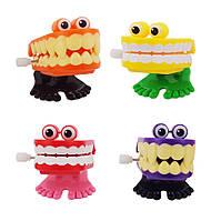 Заводная игрушка Зубы (уп. 12 шт)