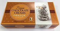 Цукерки Belgian 100г Кремові в шоколаді зі смаком апельсину