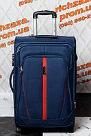 Средний вместительный синий чемодан Wings