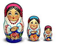 Матрёшка – Украинка в цветах из трех (дерево) 7 см