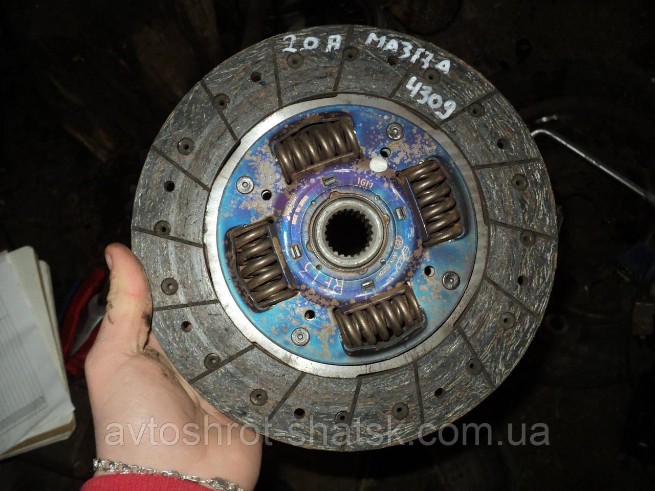 Б/у диск сцепления для Mazda 323F.