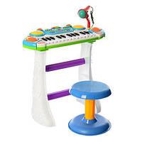 Детское электронное пианино с микрофоном в комплекте стульчик.