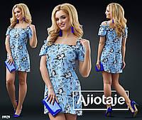 Платье в цветочный узор на широких бретелях.  Цвет - желтая,розовая,голубая основа, цветочки.