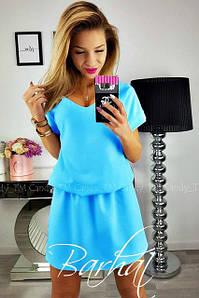 Стильное летнее однотонное  мини платье с вырезом на спине голубое