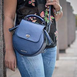 Модная круглая женская сумка из натуральной кожи и замши любого  цвета.