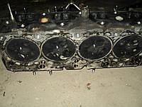 Б/у головка блока для Mazda 323F.