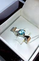 Серебряное кольцо с фианитом и золотыми вставками