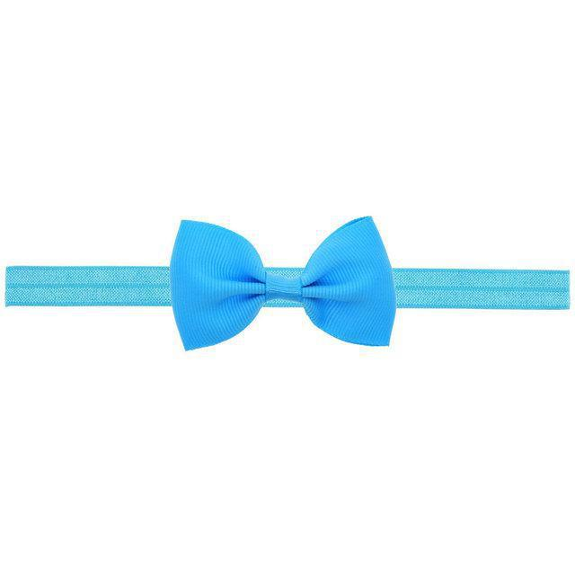 Повязка на голову с бантиком для девочки голубая