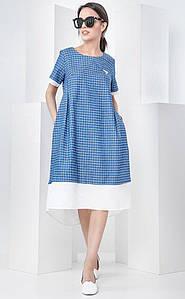 Легкое женское платье с асимметричным низом