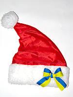 """Новогодняя Шапка Деда Мороза Колпак Санта Клауса Santa Claus красная с бантом """"флаг Украины, фото 1"""