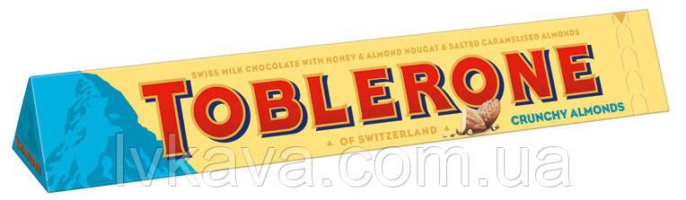 Молочный  шоколад Toblerone  c соленым карамелизированным миндалем и нугой из меда и миндаля , 100 гр