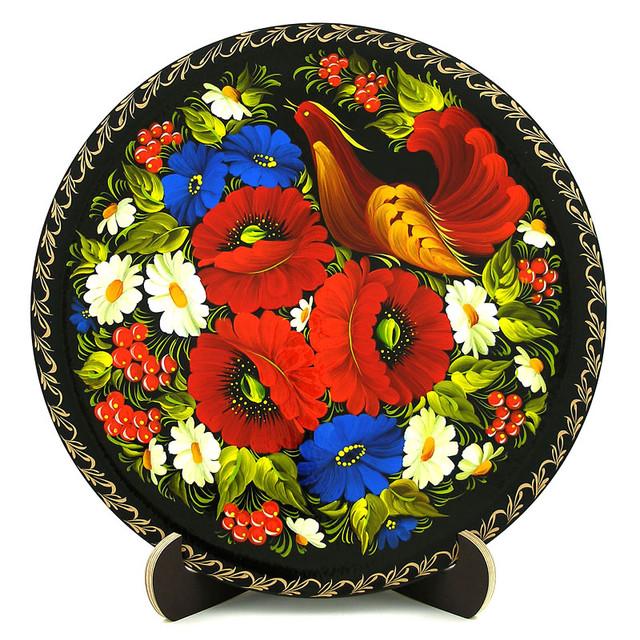 Деревянная тарелка, расписанная в технике Петриковская роспись. Цветочные мотивы