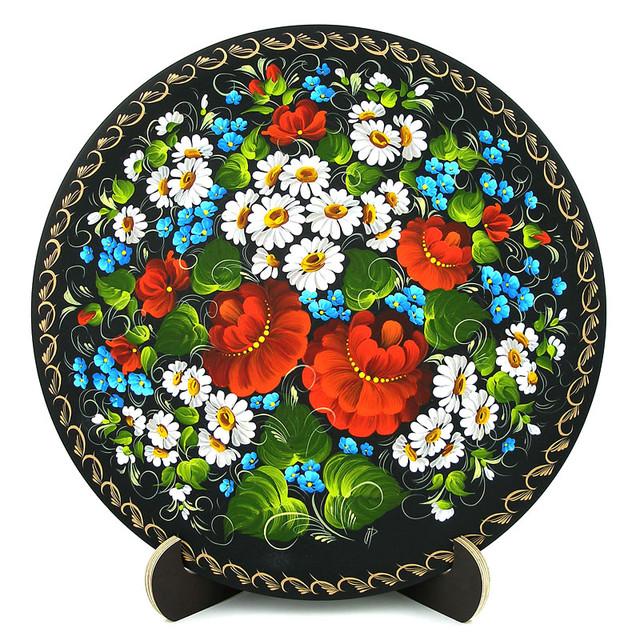 Деревянная тарелка, расписанная в технике Петриковская роспись.