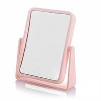Розовое косметическое квадратное настольное зеркало.