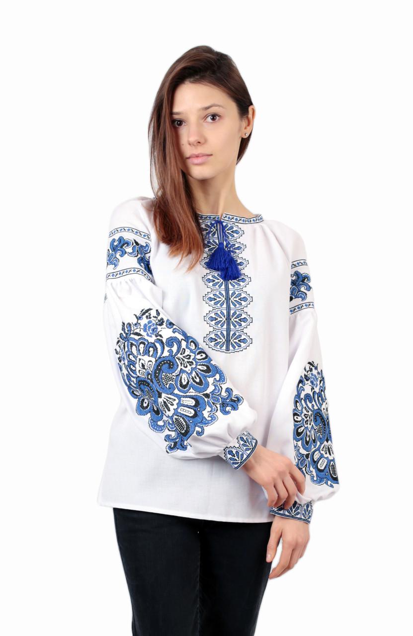 Жіноча вишита сорочка білого кольору з машинною вишивкою