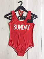 Красный слитный купальник с надписью ТМ Exclusive.