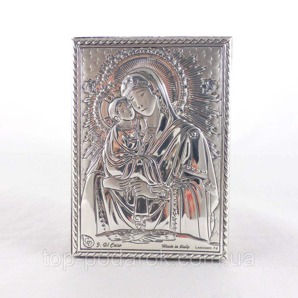 Почаївська ікона на дерев'яній основі