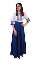 Вишите довге плаття на габардині біло-синього кольору з машинною вишивкою