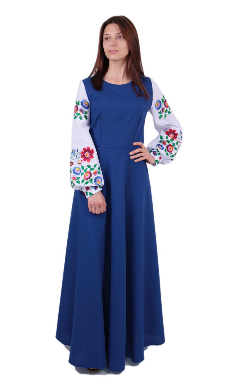 Вишите довге плаття на габардині синього кольору з машинною вишивкою на довгий рукав