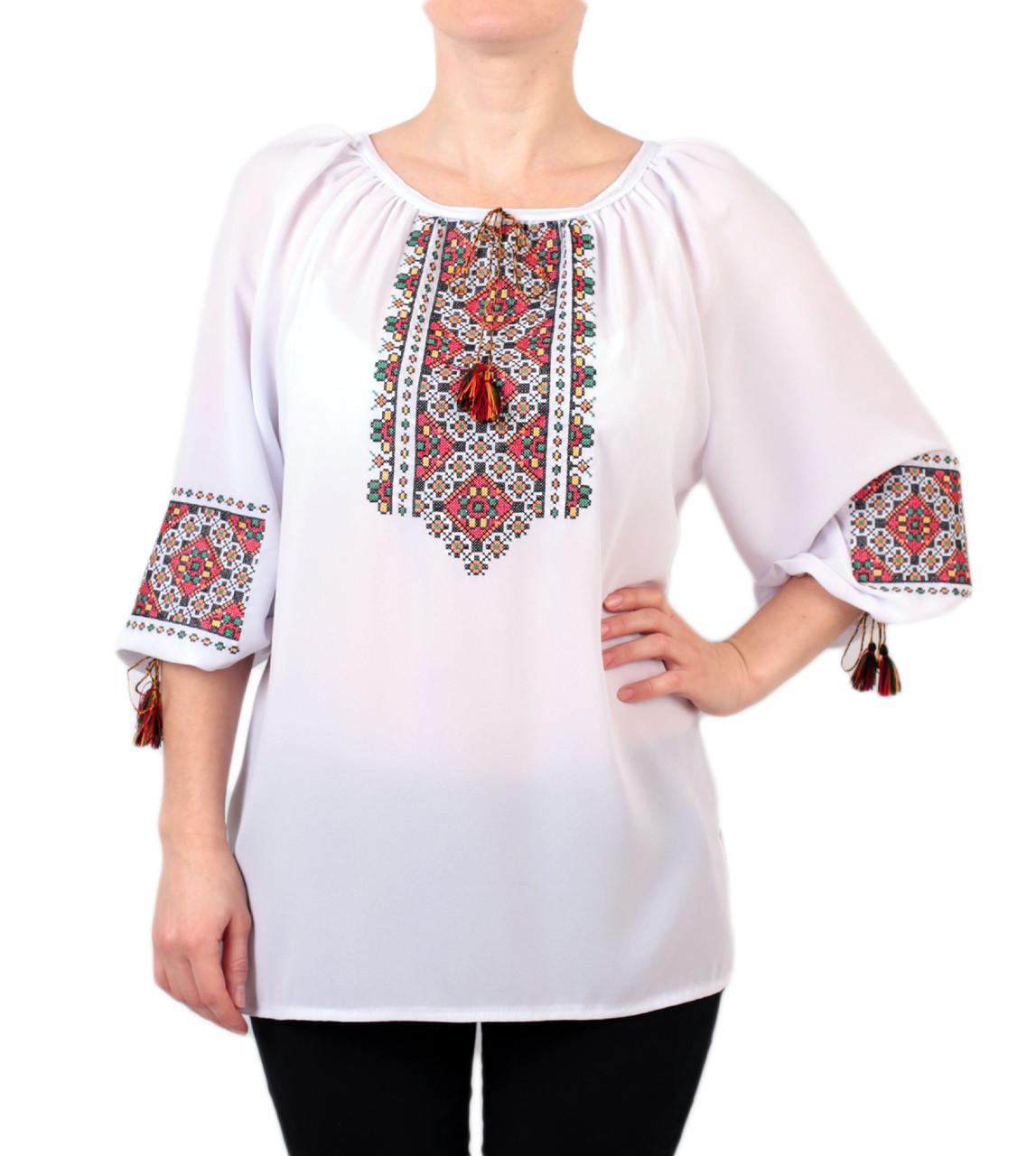 Жіноча шифонова блузка білого кольору з етнічним орнаментом недорого
