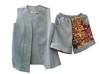 Модный костюм с паетками