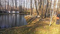 Участок в лесу со своим озером