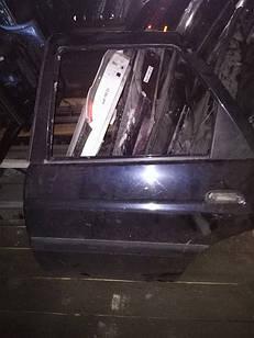 Б/у дверь задняя левая для Ford Escort 96