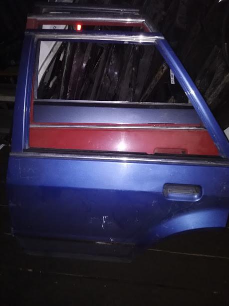 Б/у дверь задняя ліва для Ford Escort '88