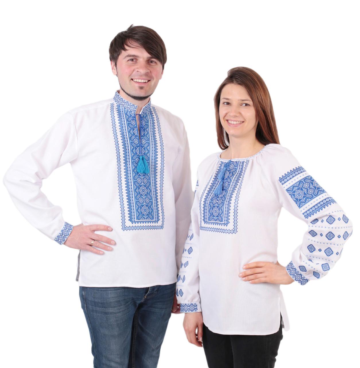 Пара вишиванок білого кольору з голубим орнаментом з машинною вишивкою