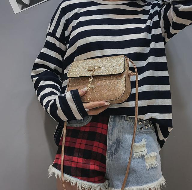 c890f75ea70f Женская блестящая мини сумка. Выполнена из кожи PU. Сверху покрыта рифленым  перламутром с маленькими блестками. Хорошо держит форму.