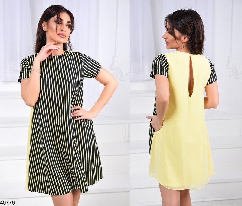 Модное платье выше колена свободное с коротким рукавом и вырезом на спине желтое