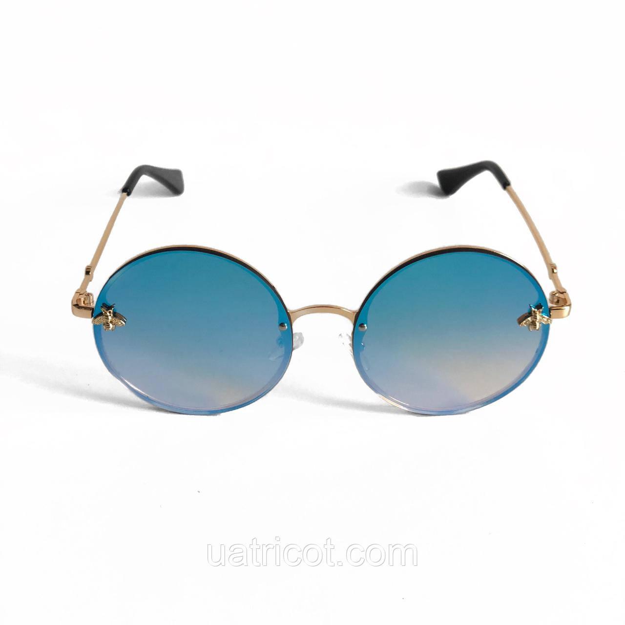 Женские круглые солнцезащитные очки с голубой зеркальной линзой