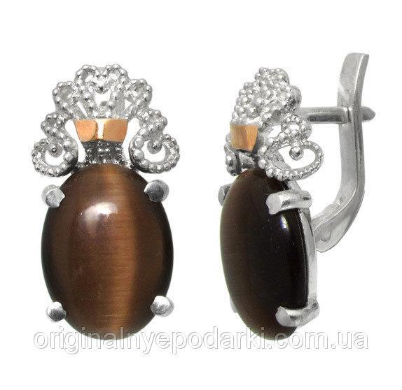 серьги Джамала с коричневым камнем