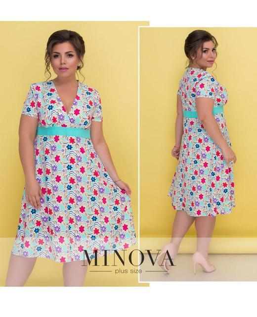 Платье с глубоким декольте на завышенной талии и короткими рукавами. Размеры: 50-58
