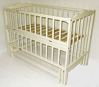"""Дитяче ліжечко  Кузя """"Анастасія"""" слонова кістка з відкидною боковинкою."""