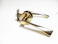 Ручка дверная межкомнатная с защелкой на кругу Браво сатин золото