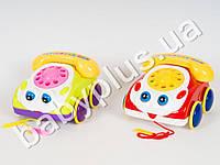 Каталка машинка-телефон, звук, 2 цвета, двигает глазами, показывает язык, в кульке
