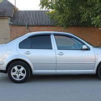 COBRA TUNING Дефлекторы окон на Volkswagen Jetta/Bora IV '98-05 (накладные)