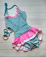 Сдельный купальник для девочки бело-голубой с розовой баской и цветами