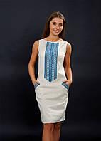 Женское платья вышитое с голубой вышивкой