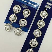 Набір прикрас довгі сережки і браслет в сріблі з розкішними прозорими кристалами і перлами