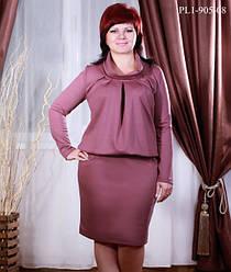 Теплий жіночий одяг великих розмірів