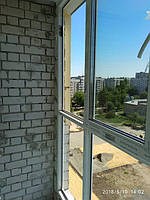 Балконная рама в профиле Rehau Euro 70. Еще в процессе установки.