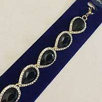 Золотой браслет с черными камнями в виде капли со стазами по кругу